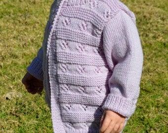 Size 2 100% merino wool hand knitted cardigan