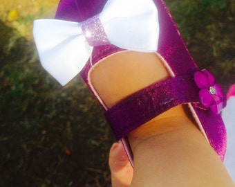 purple and white bow with a touch of sparkle