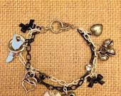 Silver Black & White Twisted Heart Charm Bracelet