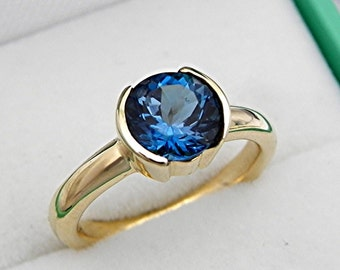 AAAA London Teal Blue Topaz Round   7.0mm  1.57 Carats   Heavy bezel set 14K Yellow gold Stack-able Engagement ring. 2110(2)
