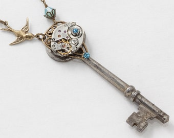 Steampunk Necklace Antique skeleton key with silver watch movement & blue opal crystal bird pendant gold filigree Statement necklace