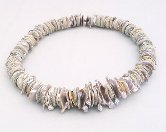 Encyclopedia pages fragments and fine keshi pearls necklace