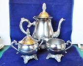 Three piece Silver Plate Footed tea service signed Estelle, Large Tea Pot, lidded Sugar bowl and Creamer Set, Circa 1960's