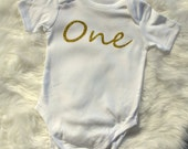 Baby top.Singlet,body suit.With snap clip fastenings.one piece.First birthday outfit.Gold glitter one.Baby girl gift.pink and gold birthday.