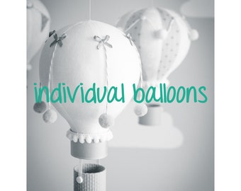 Single hot air balloons, custom colors and decorations