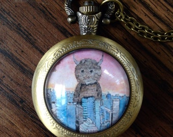 Monster in the City Pocket Watch Necklace