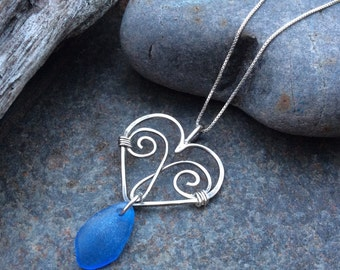 Sea glass jewelry,  Cornflower blue sea glass dangles from sterling silver heart necklace