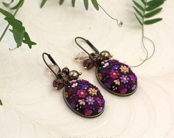 The joyous dance. Handmade applique flowery clay earrings.
