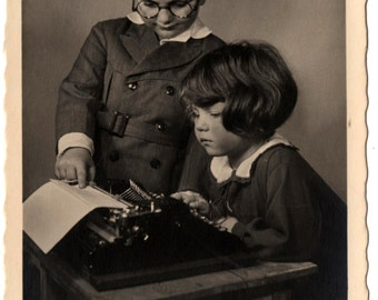Postcard of Torpedo Portable Typewriter with Cute Kids