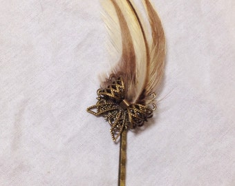 Tan and brown feather and bronze bow bobby hair pin