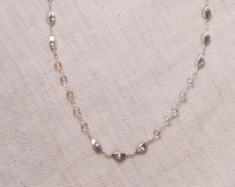 Long silver bead and glass necklace