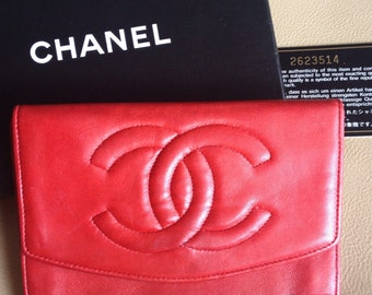 Vintage CHANEL classic leather wallet purse, card case in red color with large CC stitch logo and golden charm.