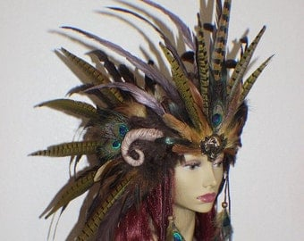Custom bronze, gold, copper, brown and green feather headdress with tiger medallion and sculpted ram inspired horns