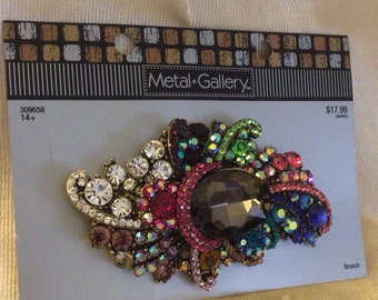 Faux Brooch with beautiful colors.