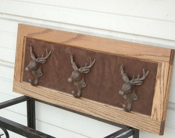 Deer Head Coat Rack On A Salvaged Oak Cabinet Door with Iron Hooks and Suede Background