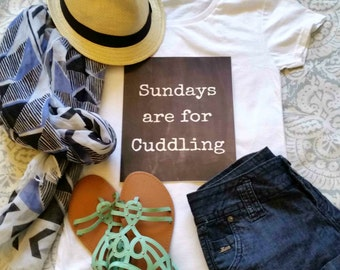 Sundays are for cuddling quote t-shirt available in size s, med, large, and Xl for juniors girls and women
