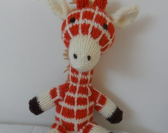 Cedric the hand knitted giraffe soft toy designed by Alan Dart, knitted by Liz