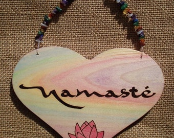 Heart shaped Namaste sign with crystals