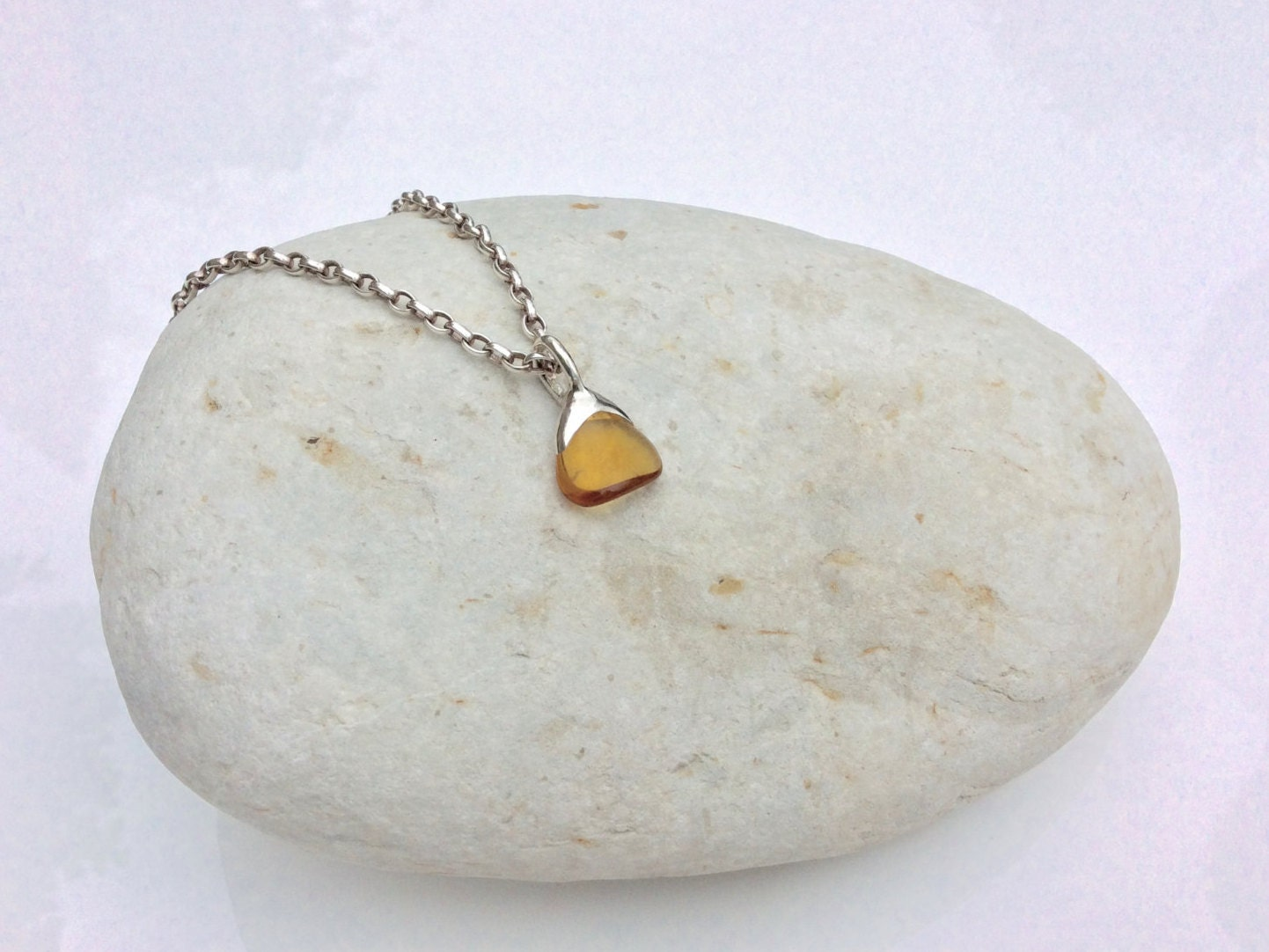 how to clean amber set in silver