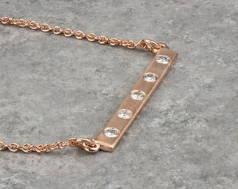 Diamond bar necklace. Available in Solid Gold and Platinum