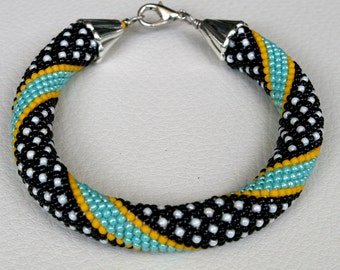 Bracelet with beads Japanese TOHO, crochet, Jewelry, Beadwork, Beaded Bracelet, crochet technique slashes, Turquoise, Black, Sunshine, White