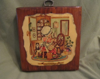 wooden wall hanging/ plaque of litle girl working on spinning wheel 5 and 1/2 inches
