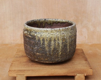 Wood fired stoneware tea bowl with light green glaze