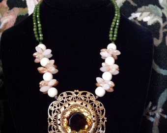 Two strand necklace with vintage pendant