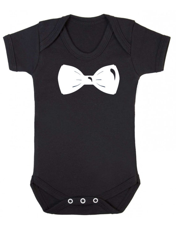 Gorgeous footless organic cotton baby grow with hand printed tuxedo design. Co-ordinate with your outfit by choosing the bow tie and rose colour. Can be washed at 40 degrees and ironed on reverse.