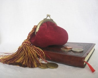 Burgundy velvet purse for coins with a tassel and clasp