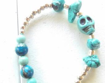 Turquoise stone and bead skull bracelet