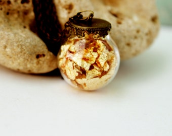 Glass pendant full of gold leaf particles. Vintage necklace.