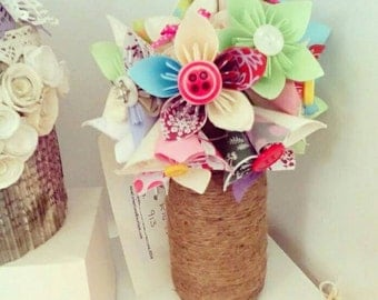 Beautiful handmade paper flowers in a wrapped vase