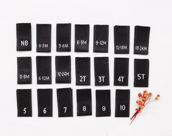 "Woven Size Tabs - For Childrens & Baby Clothing - Black Labels with White Letters - Center Fold - 0.375""(W) x 0.75""(H) Folded Size"