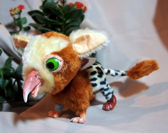 Poseable fantasy creature, tropical Gryphon baby.