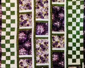 Floral purple and green paneled quilt