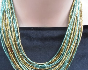 Turquoise, brown and gold , beaded necklace