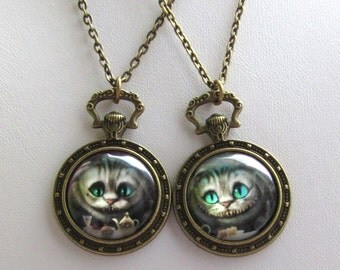Alice in Wonderland Cheshire Cat, Tim Burton style,pendant and chain in bronze coloured settings with white rabbit detail