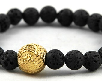 Bracelet made of lava stone and gold-plated node