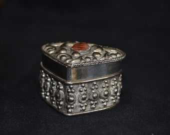 Heart shaped metal trinket box.
