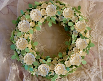 Wreath from paper flowers and branches