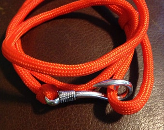 Orange paracord braclet with fish hook latch
