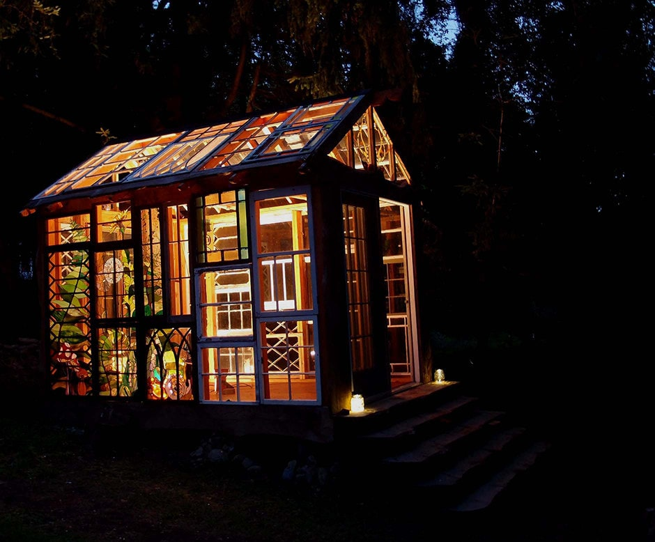 Glass cabin at night