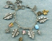 Lovely Leaves   an assemblage charm bracelet, silver leaves silver,gift for her,leaf, unique charm bracelet,art bracelet,OOAK charm bracelet