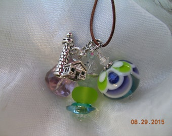 The Lighthouse   All-Artisan Lampwork, Aquamarine, Pink Amythest Lighthouse Pendant