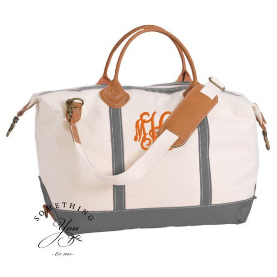 Monogrammed leather and natural canvas weekender bag