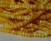 Candy jade faceted rondelle 4mm yellow one 15-inch strand (item ID YWCJLY6m)