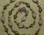 Hand knotted semi precious rose quartz, Peridot, garnets and Bali sterling silver necklace