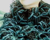 Hand knitted Ruffle Scarf in Dark Green Teal edged in Sparkling Blue Teal trim.