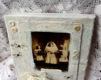 I Love To Tell the Story  8 x 10 inch altered canvas with vintage cabinet card laces and embellishments